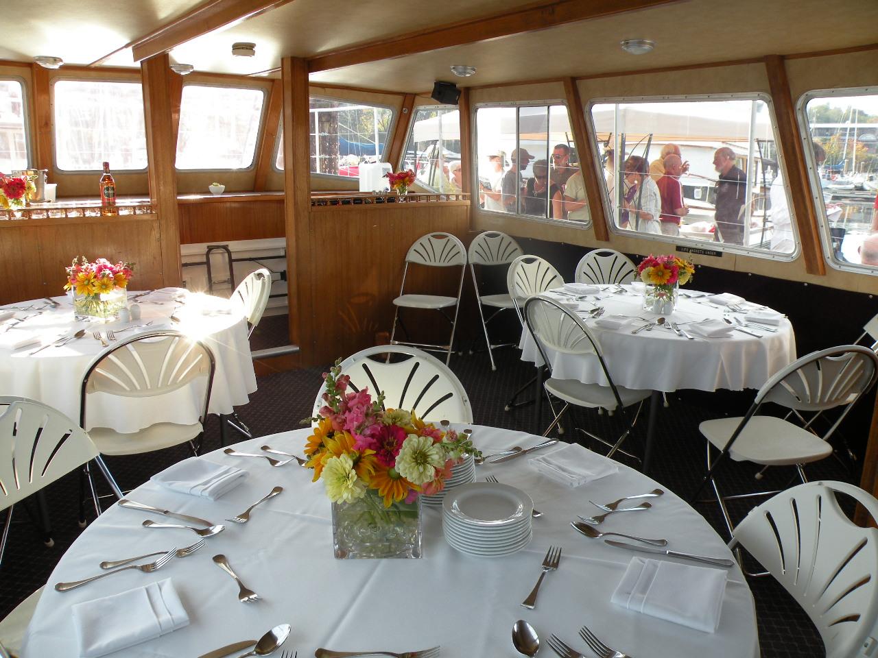 Tables set for dinner on boat